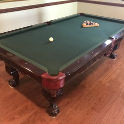 8' Leisureworld pool table. Accessories and Cue Rack. Solid Wood, Slate top. Buyer must pick up.